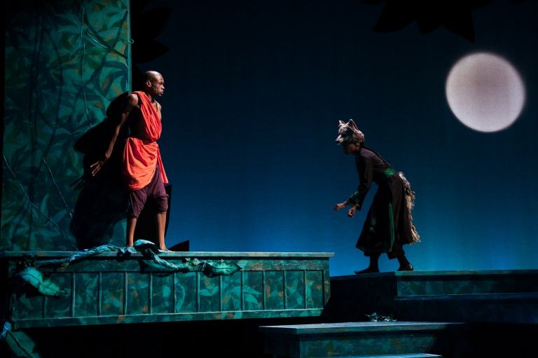 Mowgli is greeted by the wolf pack - The Jungle Book at IStage